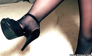 On the other hand exposed to her sexy high heels shoes with an increment of stockings slowly