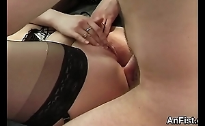 Nasty lesbo honeys are gaping and fist fucking anals